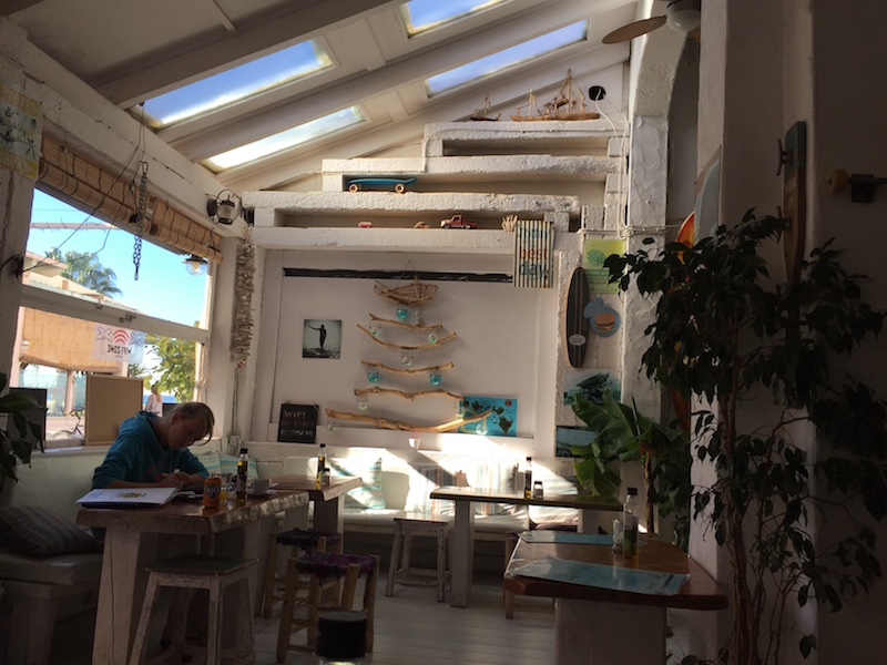 Image showing the office of a digital nomad. It displays Stocked, a cafe in Tarifa, Spain that is nicely decorated.