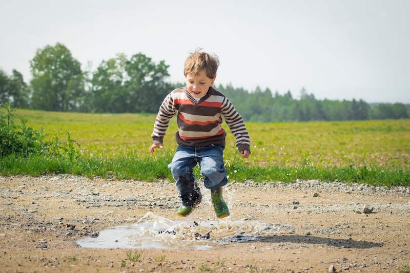 Children jumping in a puddle, enjoing the moment and having fun, like people listening to their inner voice.